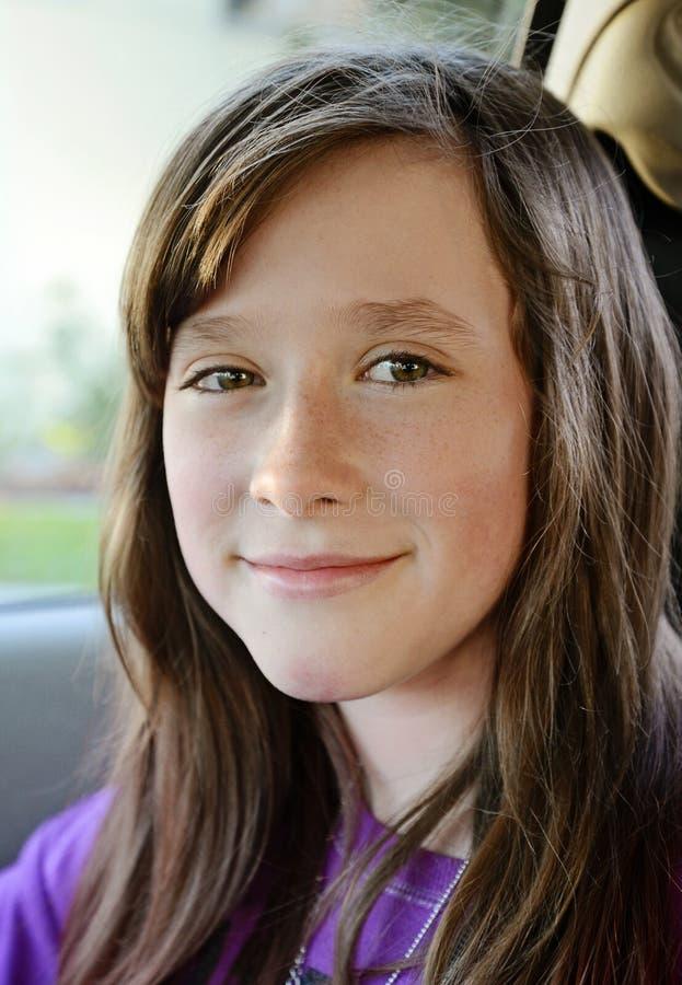 Sourire de jeune fille image stock