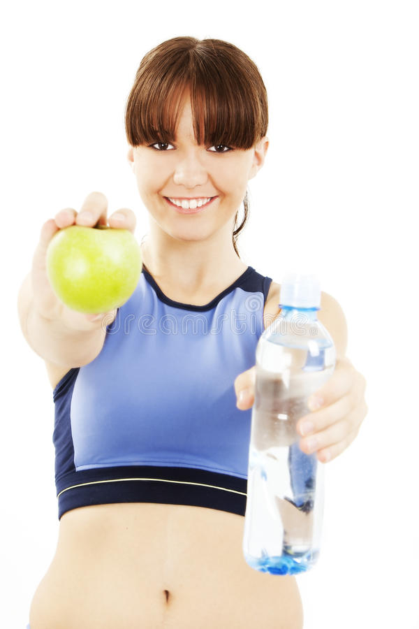 Sourire de pomme de consommation de femme de forme physique heureux image stock