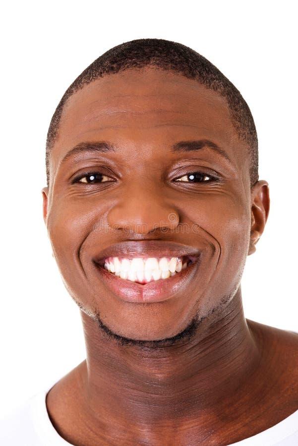 Sourire du visage du jeune mâle beau. photo stock