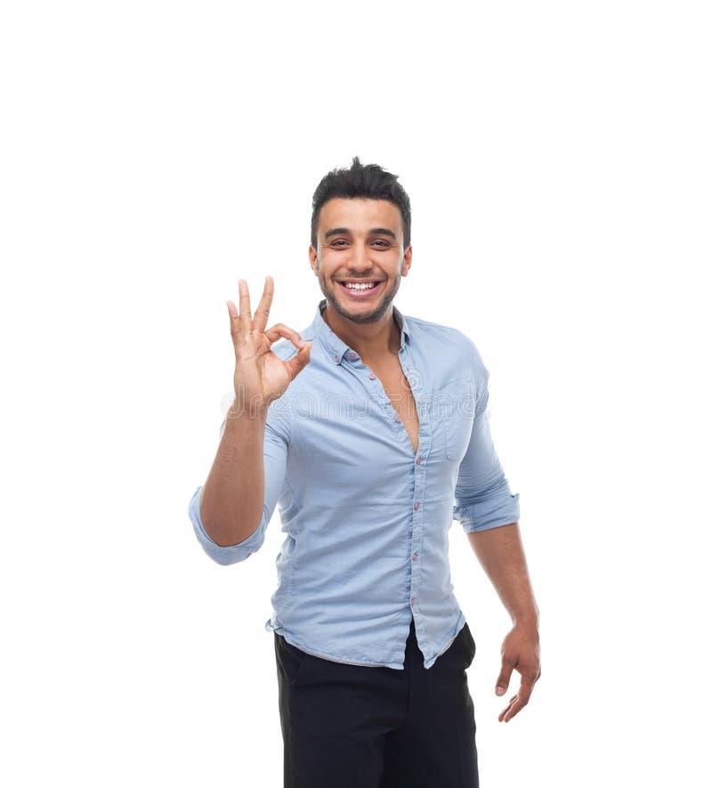 Sourire heureux beau d'homme d'affaires, main de prise d'homme d'affaires avec le signe correct de geste image libre de droits