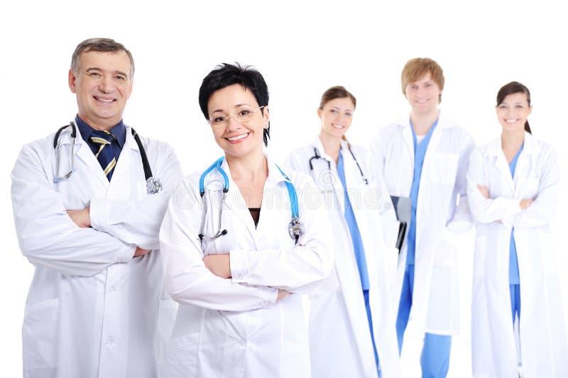 sourire heureux d'hôpital de robes de médecins photo libre de droits