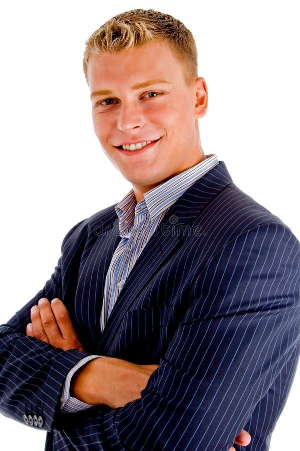 sourire mâle croisé par bras américains photos stock