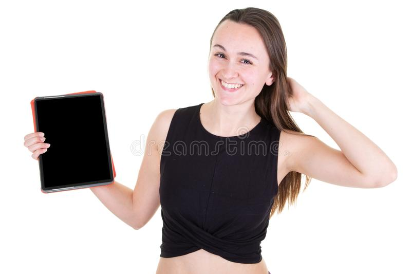 Sourire noir vide d'écran de tablette d'apparence de jeune femme image stock
