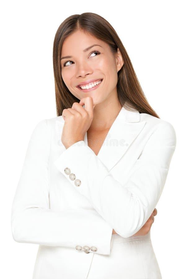 Sourire pensant de femme images stock