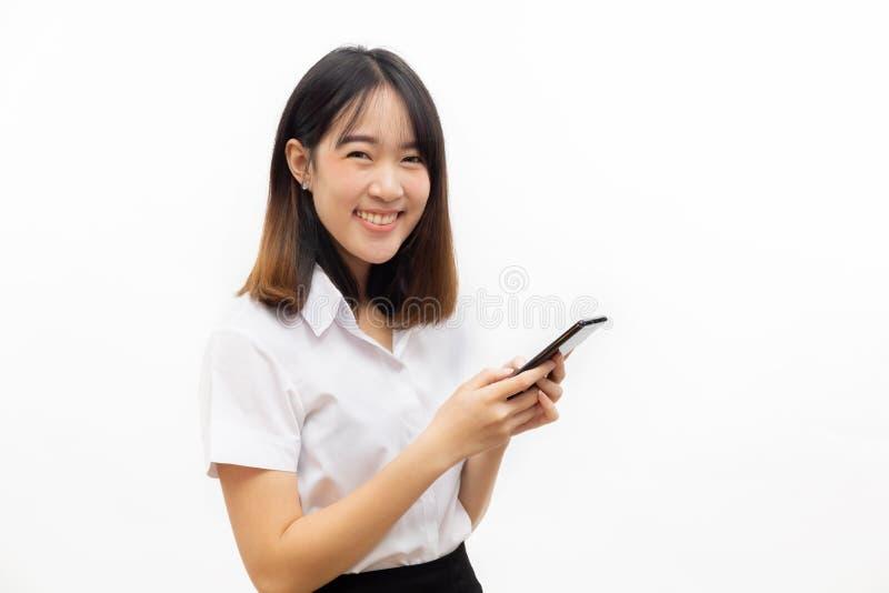 Sourire robe formelle femelle asiatique heureuse et gaie tenant un s image libre de droits