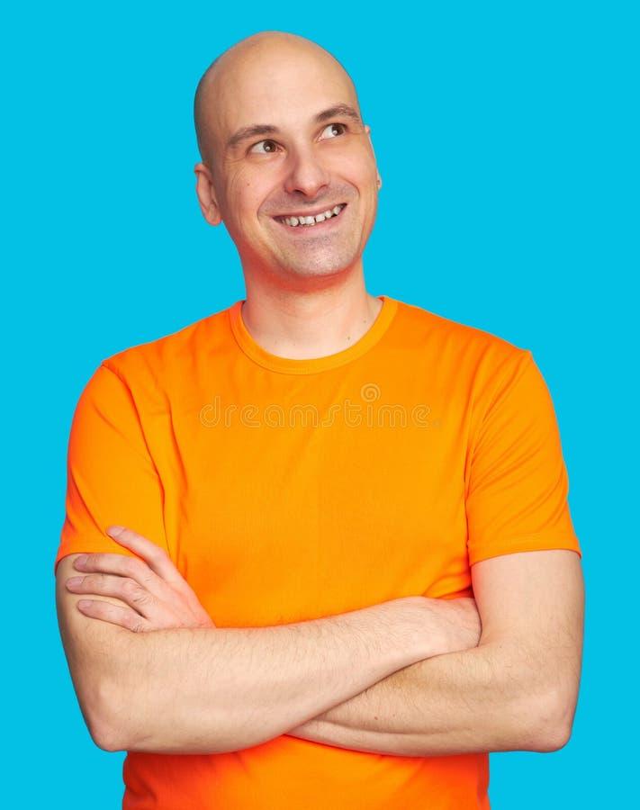 Sourire toothy d'homme chauve heureux et recherche photographie stock libre de droits