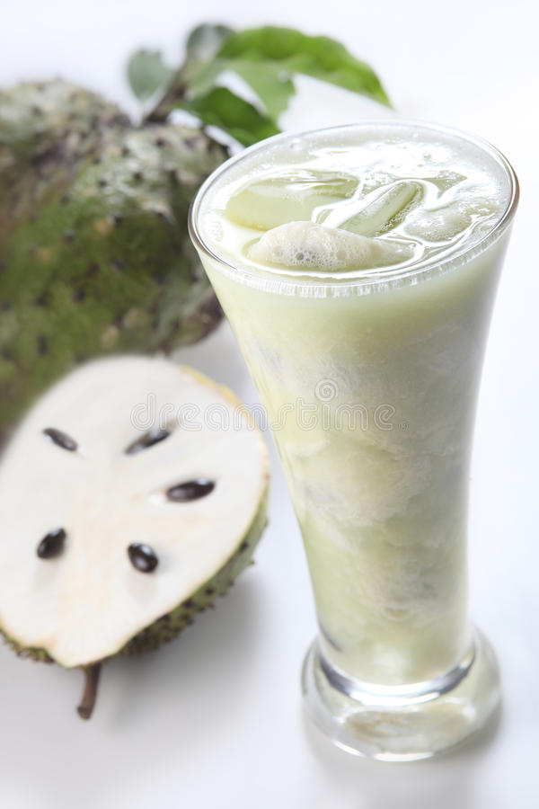 Soursop fruit juice. On clean background royalty free stock photos