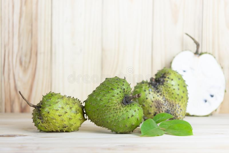 Soursop fruit on wooden table. stock images