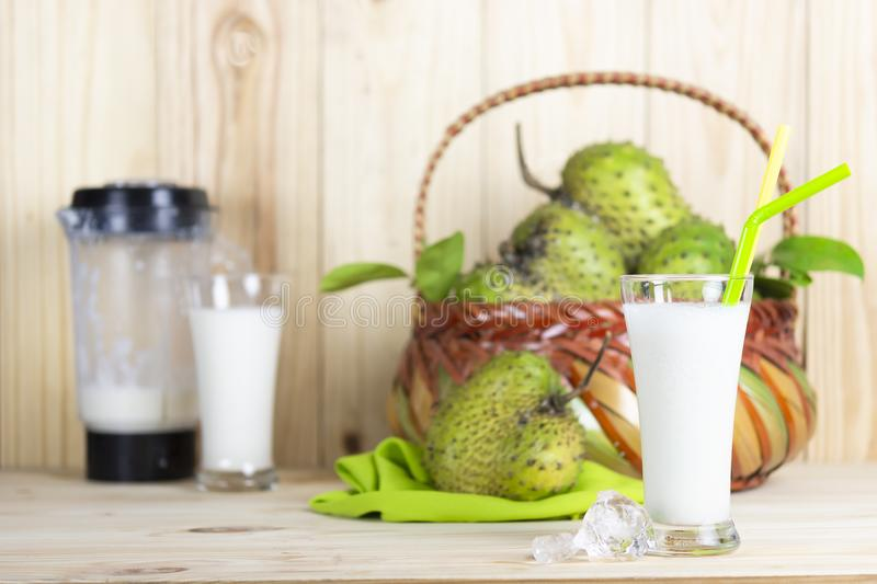 Soursop juice and soursop fruit or Prickly Custard Apple or Annona muricata L on wooden table. royalty free stock photo