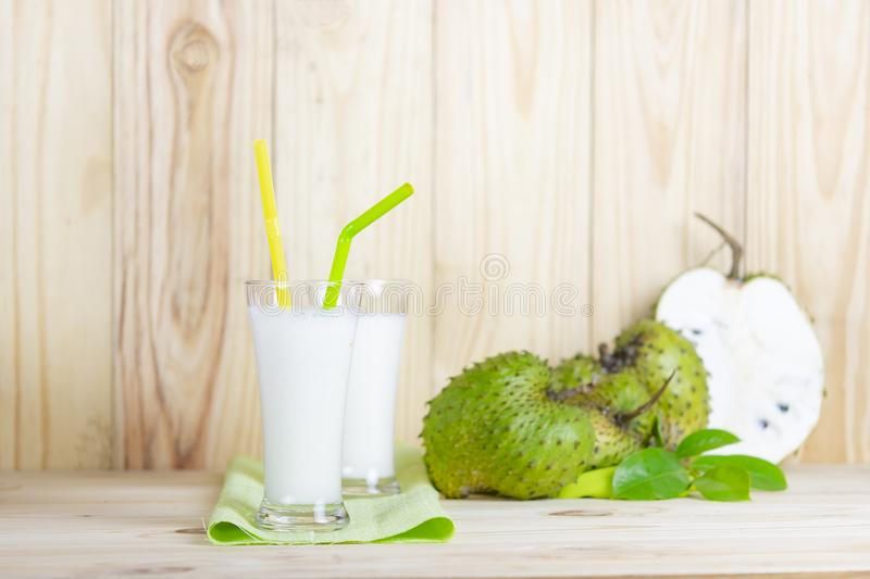 Soursop juice with soursop fruit on wooden table. royalty free stock photos