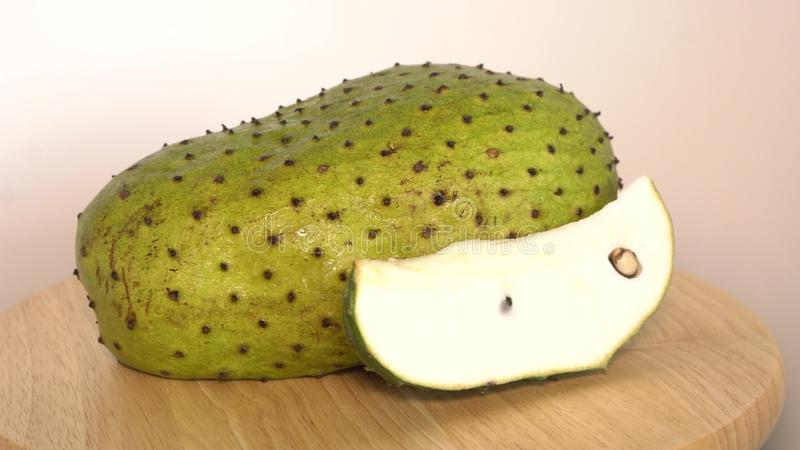 Soursop, Prickly Custard Apple with slice on wooden cutting board stock photos