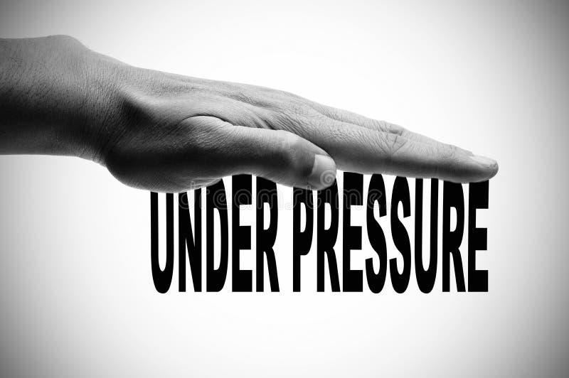 Sous pression image libre de droits