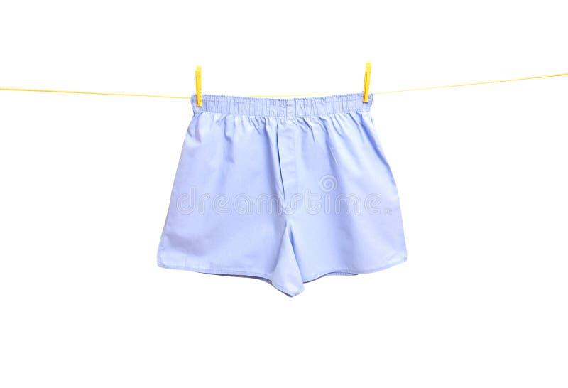 Sous-vêtements d'homme sur la corde à linge photo stock