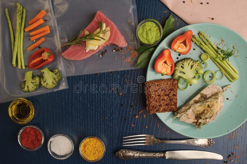 Sous vide. Tuna and vegetables on platter and as ingredients for. Cooking at low temperatures. Horizontal stock photo