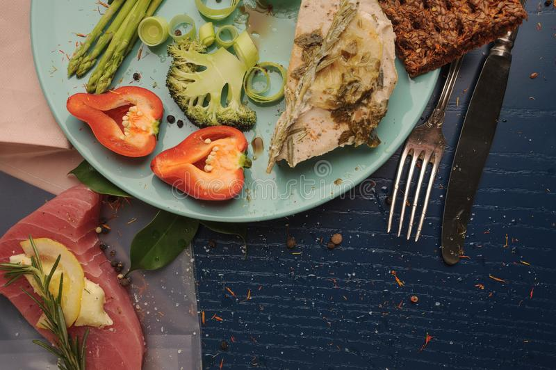 Sous vide. Tuna and vegetables on platter and as ingredients for. Cooking at low temperatures. Horizontal royalty free stock photos