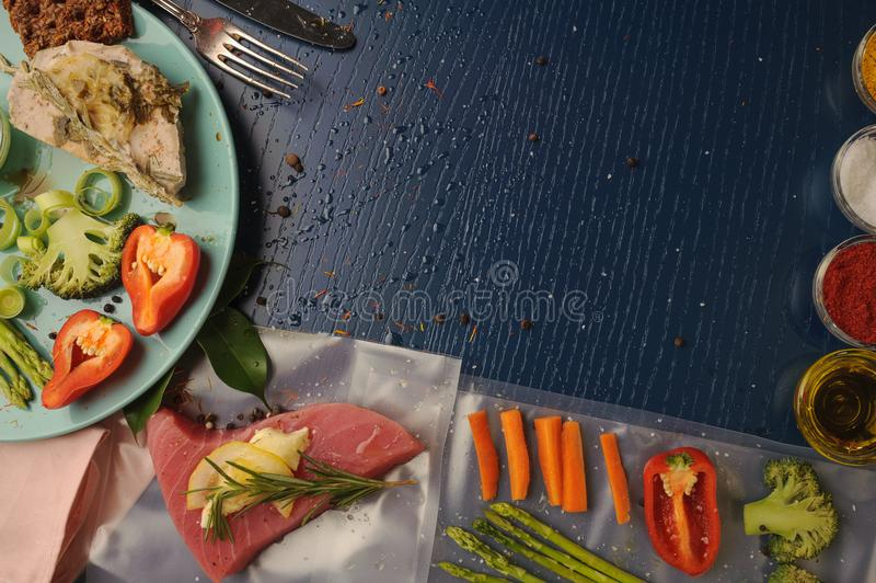 Sous vide. Tuna and vegetables on platter and as ingredients for. Cooking at low temperatures. Horizontal royalty free stock image