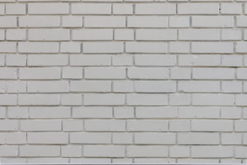 Soustrayez le vieux stuc souill? par texture superficiel par les agents gris-clair et avez vieilli le fond blanc de mur de brique image stock