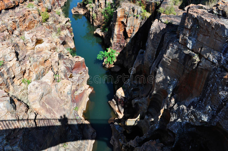 South Africa, East, Mpumalanga province, Bourke`s Luck Potholes, Blyde River Canyon, Nature Reserve. South Africa, 01/10/2009: shadow of the pedestrian bridge on stock photo