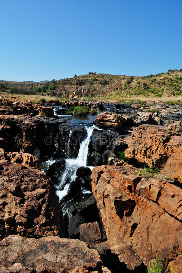 South Africa, East, Mpumalanga province, Bourke's Luck Potholes, Blyde River Canyon, Nature Reserve. South Africa, 01/10/2009: a waterfall on the black royalty free stock photography