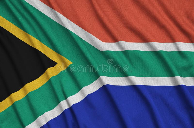 South Africa flag is depicted on a sports cloth fabric with many folds. Sport team banner stock photography