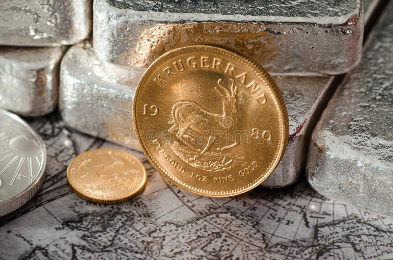 South Africa Gold Coin Kugurand with Silver Bars.  stock photography