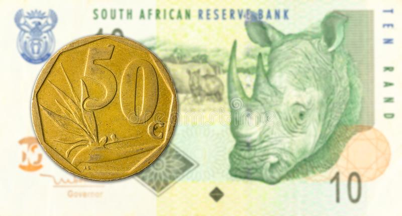 50 south african aforika coin against 10 south african rand banknote. Specimen stock images
