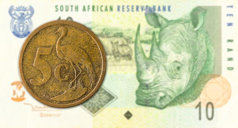 5 south african aforika coin against 10 south african rand banknote. Specimen royalty free stock photos