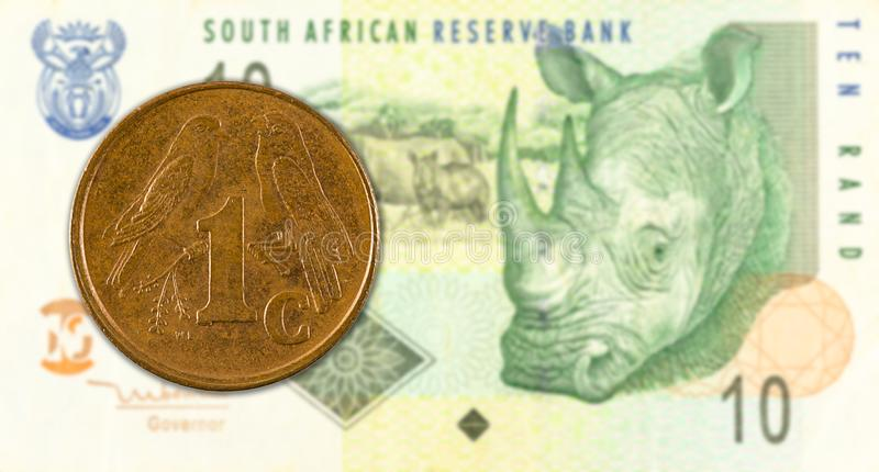 1 south african aforika coin against 10 south african rand banknote. Specimen stock image
