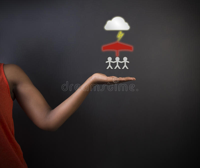 South African or African American woman teacher or student thinking about protecting family from natural disaster royalty free stock image