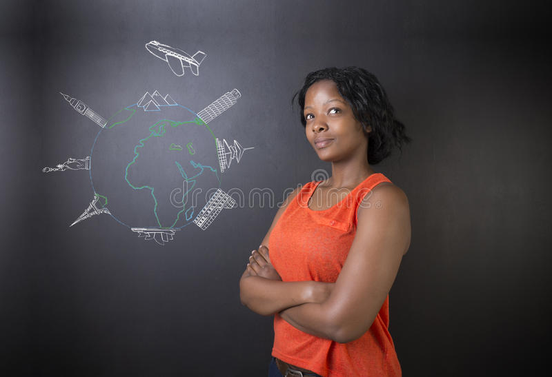 South African or African American woman teacher or student with chalk globe and jet world travel. South African or African American woman teacher or student stock photography