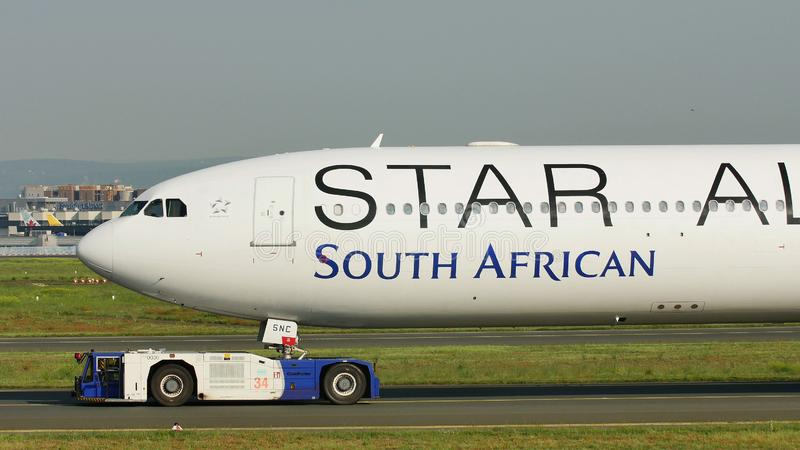 Star Alliance South African Airways plane being towed in Frankfurt Airport, FRA. South African aircraft doing taxi in Frankfurt stock photography