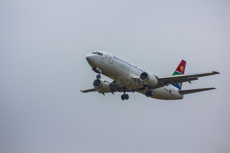 South African Airways. Landing at OR Tambo airways international, with landing gear down, flaps open stock image