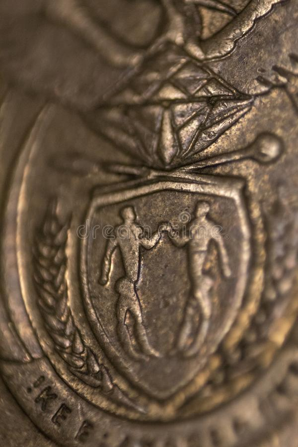 South African close up coin, symbol of South Africa. With shields stock photos