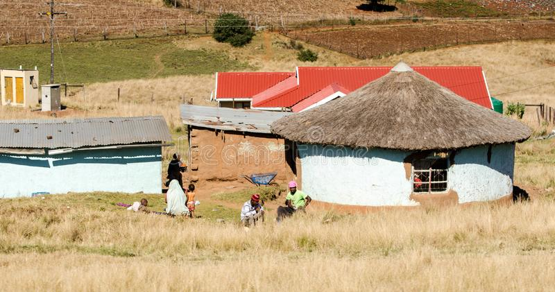 South african family near a traditional mud house in a small village, South Africa, apartheid, KwaZulu Natal. South african family near a traditional mud house stock images