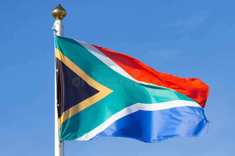 South African flag. On the blue sky stock image