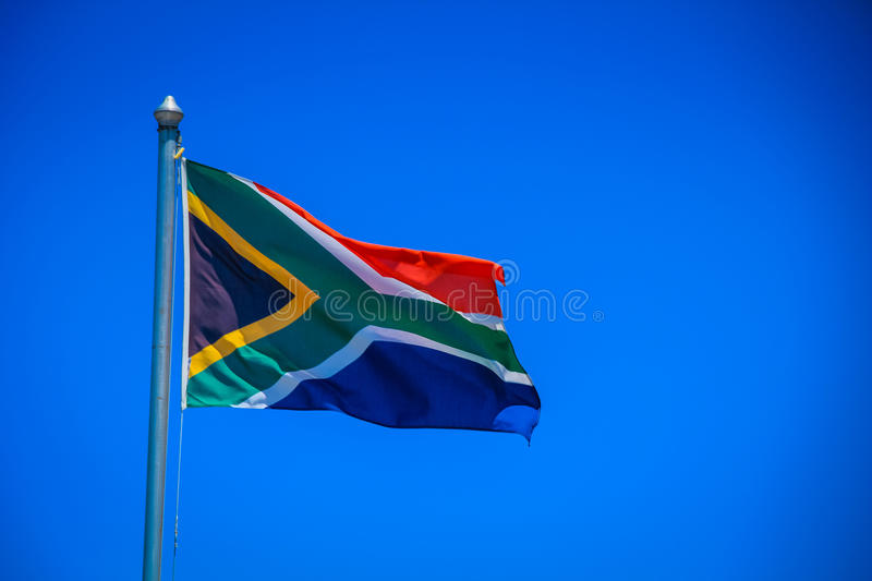 South African flag. On the blue sky royalty free stock photos