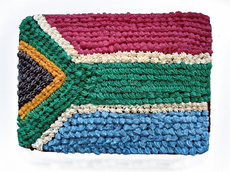 South African flag cake. A delicious square birthday cake decorated with colorful sugar icing on top showing the South African flag of the rainbow nation South royalty free stock images