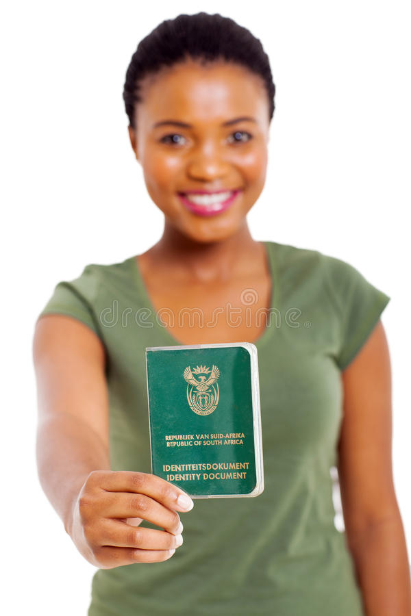 South african ID book. Smiling south african girl presenting ID book over white background stock photo