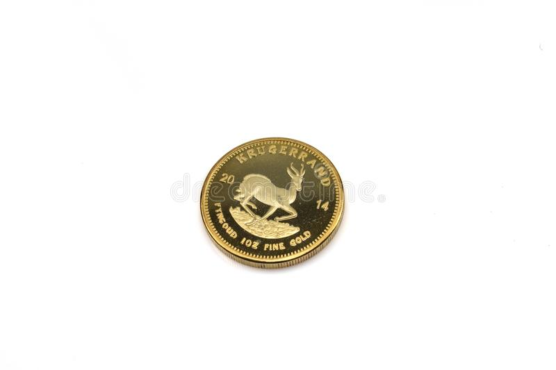A South African krugerrand close up on a white background royalty free stock image
