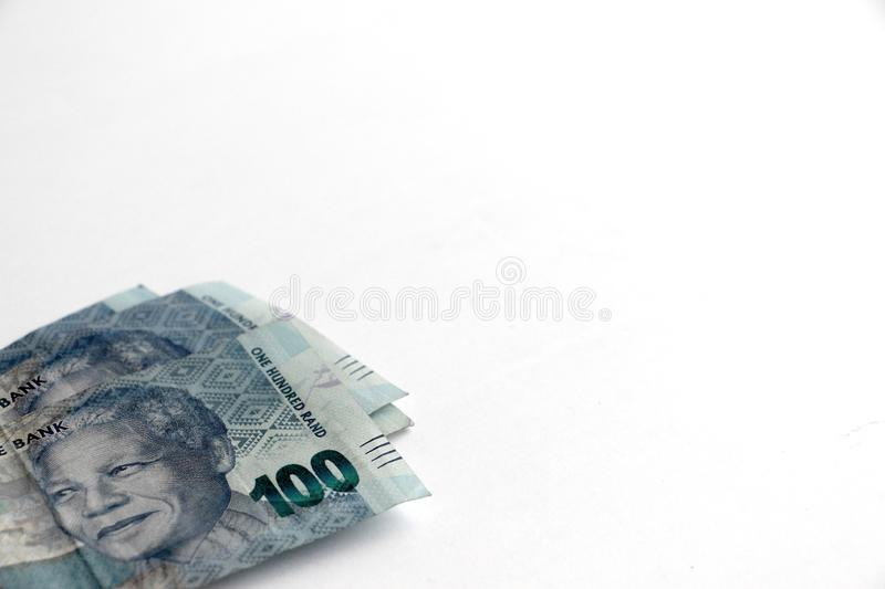 South african one hundred rand notes. South african money one hundred rand notes isolated on a white surface with space for text royalty free stock photography