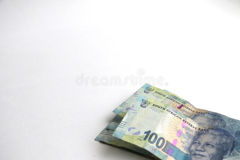 South african one hundred rand notes. South african money one hundred rand notes isolated on a white surface with space for text stock photography