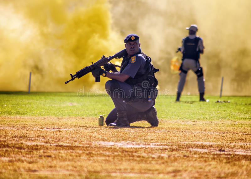 South African Police Service Officer. With rifle stock image