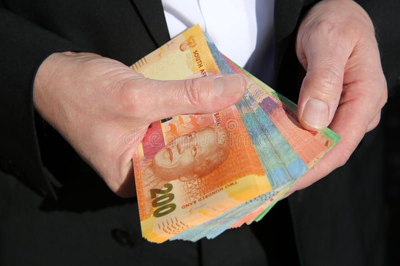 South African Rand Banknotes. Business Man with South African Rand Banknotes royalty free stock photos