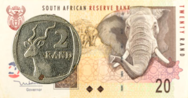 2 south african rand coin against 20 south african rand. Banknote stock photo