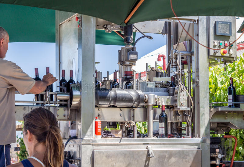 South African wine: outdoor automatic bottling line. Mobile mach royalty free stock photography