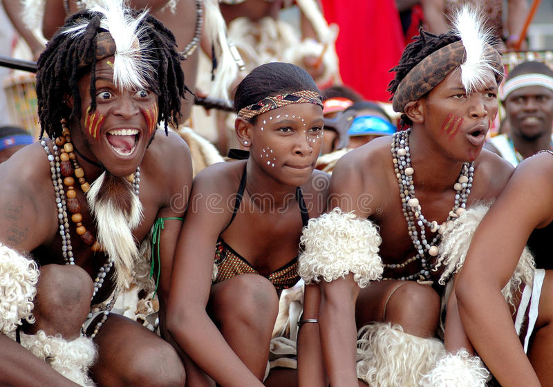 South African Zulu dancers. A group of South African Zulu dancers entertaining and performing for spectators and tourists by singing traditional songs at a night