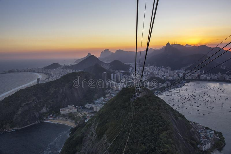 South America, Brazil, Rio de Janeiro State, Rio de Janeiro city. The cable car station on the summit of the Sugar Loaf hill with Guanabara bay behind royalty free stock photo