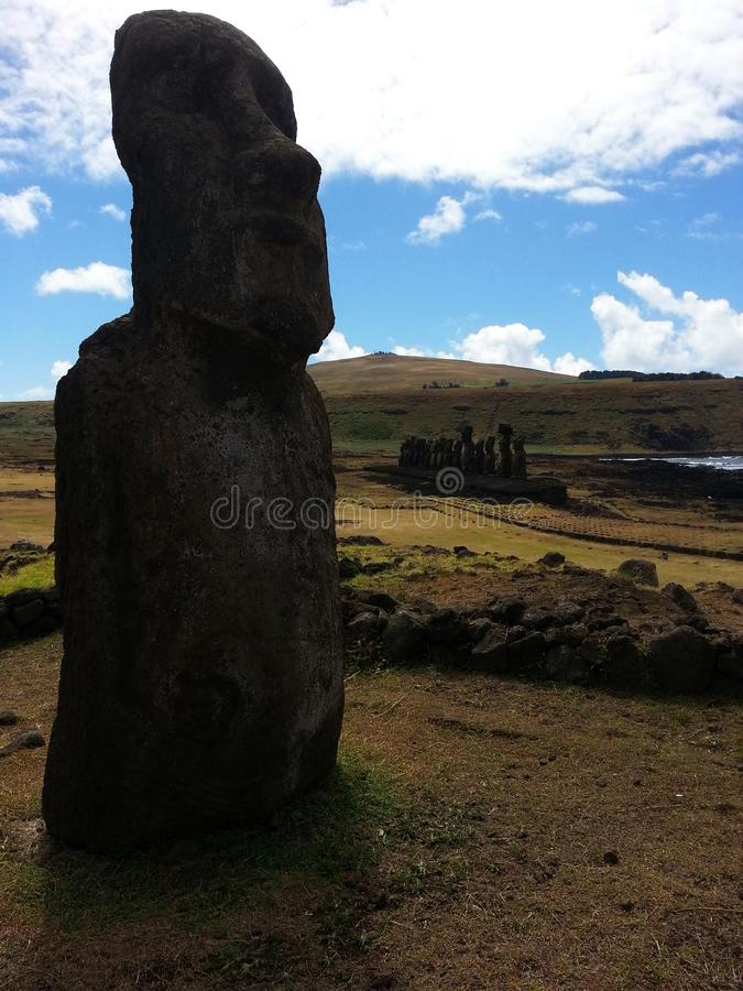 Moai at Ahu Tongariki. South America travel, Easter Island, Rapa Nui. nA moai in the iconic site of Ahu Tongariki royalty free stock photo