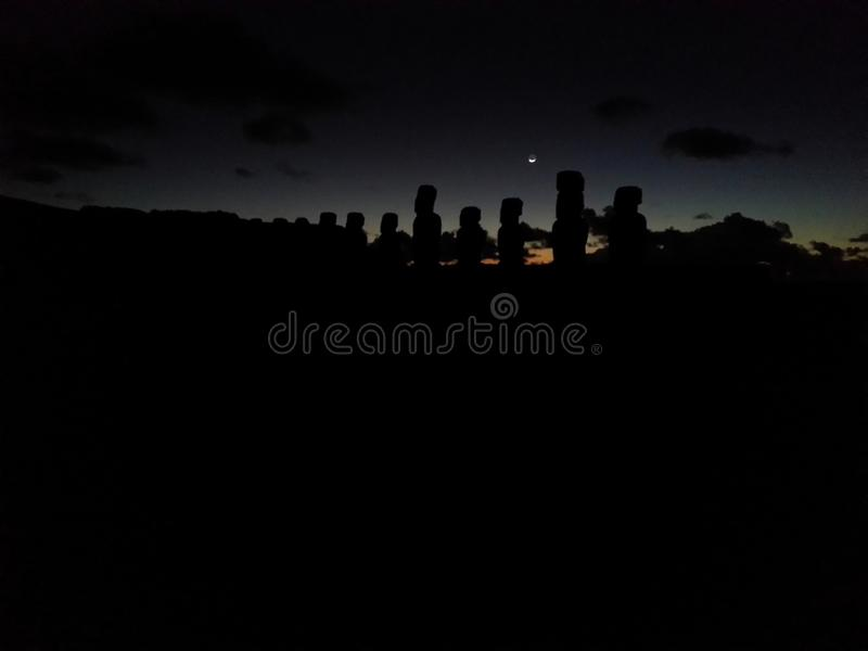 The Moai await the dawn stock images