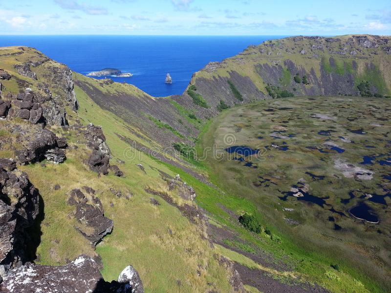 Rano Kau and the islands. South America travel, Easter Island, Rapa Nui. Special view of Rano Kau crater and the Birdman islands, amazing nature royalty free stock photo